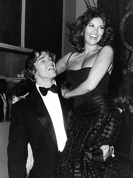 NEED A LIFT? photo | Arnold Schwarzenegger, Raquel Welch