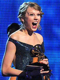 Taylor Swift Takes Four Grammys Back to Nashville