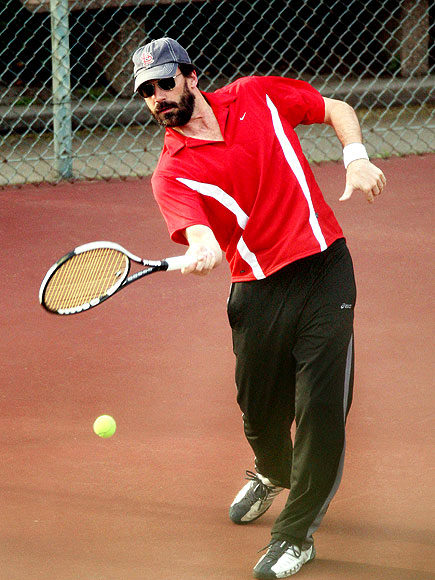 CAUSING A RACQUET photo | Jon Hamm