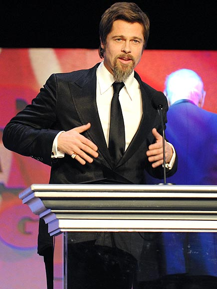 TAKING THE PODIUM photo | Brad Pitt