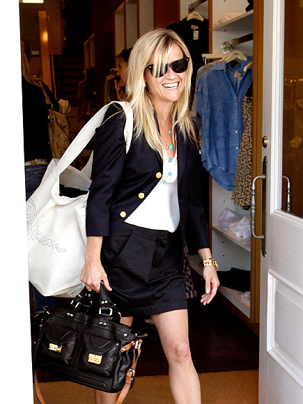 TOTE-ALLY ARMED photo | Reese Witherspoon