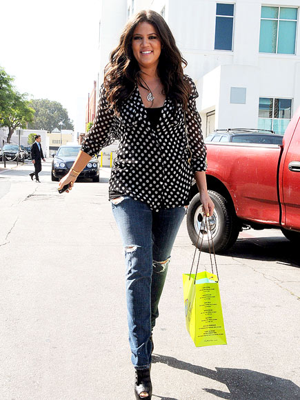 WALKING TALL photo | Khloe Kardashian