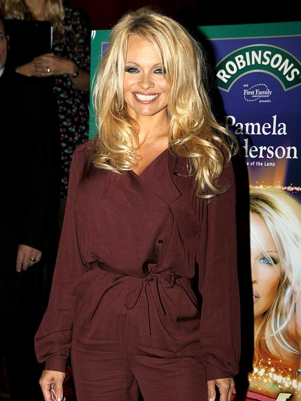 GENIE IN A BOTTLE photo | Pamela Anderson
