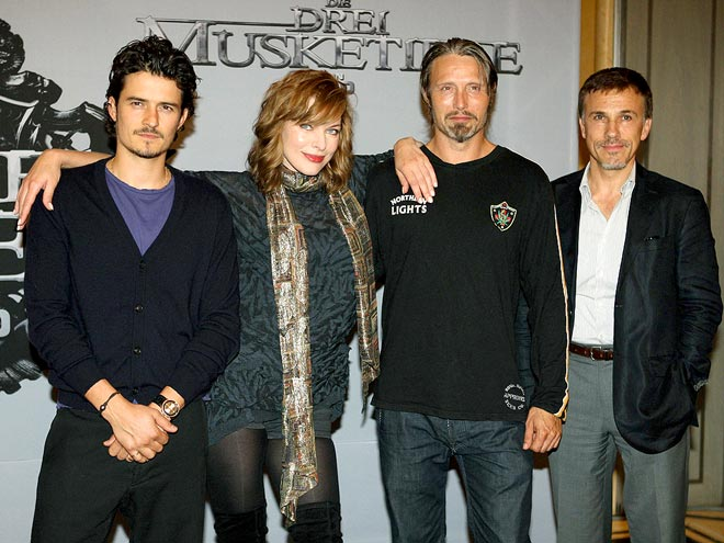 ONE 'FOUR' ALL photo | Mads Mikkelsen, Milla Jovovich, Orlando Bloom