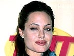 9 Years Ago: Angelina Jolie's Bashful SAG Awards Win