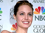 11 Years Ago: Angelina Jolie Jumps Into a Pool