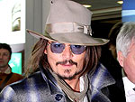 Johnny Depp Touches Down in Rome