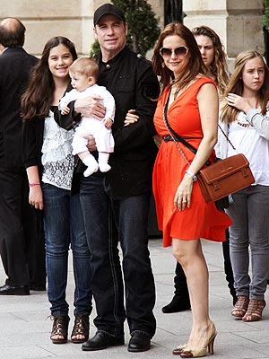Family photo of the celebrity, married to Kelly Preston, famous for Saturday Night Fever & Grease.