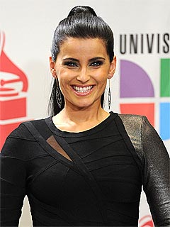 Nelly Furtado to Donate $1 Million from Gaddafi to Charity | Nelly Furtado