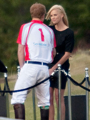 Prince Harry Chats with Charlize Theron