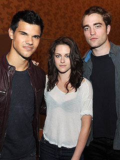 Kristen Stewart Dishes on Breaking Dawn's 'Secret Service' Style Wedding Shoot | Kristen Stewart, Robert Pattinson, Taylor Lautner