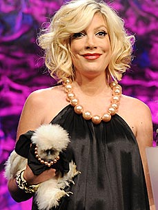 Tori Spelling Puts a Dress on Her Pet Chicken
