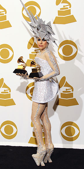 Who accepted two Grammys in an out-of-this-world ensemble?