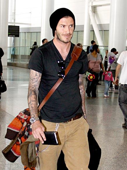 TRAVELING LIGHT  photo | David Beckham