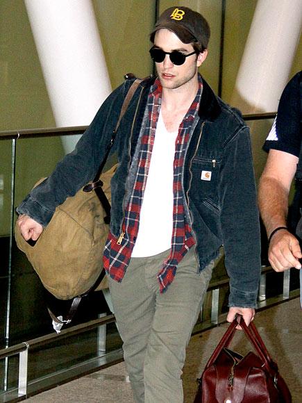 PLANE CLOTHED  photo | Robert Pattinson