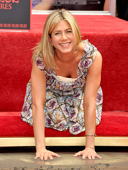 SHOW OF HANDS photo | Jennifer Aniston