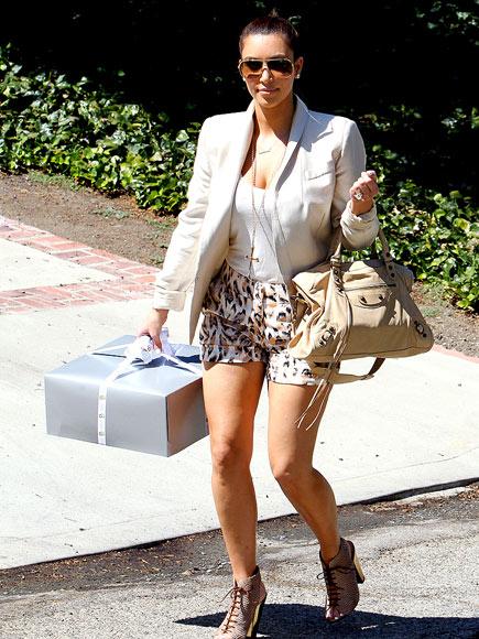 PRESENT TENSE  photo | Kim Kardashian