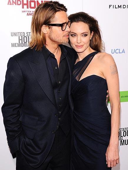 HAVING A MOMENT  photo | Angelina Jolie, Brad Pitt