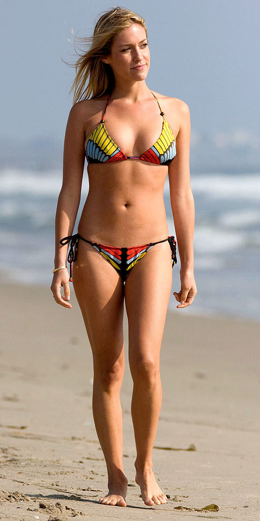 With her slim body and Dark blond hairtype without bra (cup size 32B) on the beach in bikini