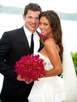 Nick Lachey and Vanessa Minnillo show off their custom wedding bands