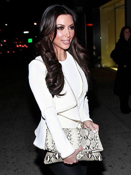 OVERSIZED SNAKY CLUTCHES photo | Kim Kardashian