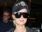 Paris Hilton Rummages Through Her Bags at JFK