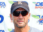 Tim McGraw Picks Up a Gun (and Takes Aim) for Charity   Tim McGraw