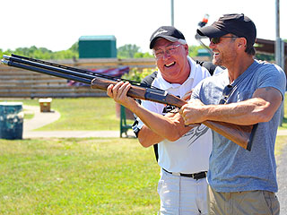 Tim McGraw Picks Up a Gun (and Takes Aim) for Charity | Tim McGraw