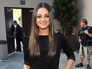 Mila Braves Rain for Madonna Concert in N.Y.C. | Mila Kunis