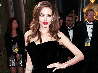Angelina Jolie Laughs Off Those Oscar-Night Leg Jokes