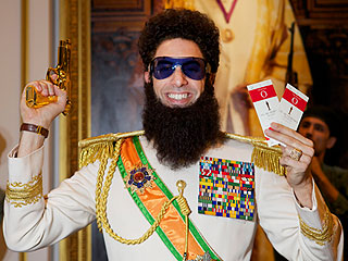 Sacha Baron Cohen&#39;s &#39;Dictator&#39; Shows Off Oscar Tickets and Golden Pistol