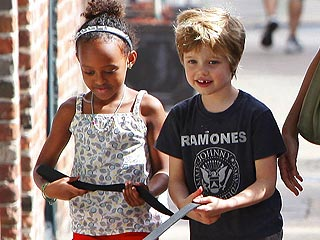 PHOTO: Jolie-Pitt Kids Walk the Dog! | Maddox Jolie-Pitt Cover, Shiloh Jolie-Pitt, Zahara Jolie-Pitt