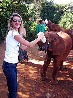 PHOTO: Gisele Bottle Feeds a Baby Elephant