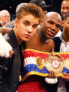 Which Music Superstar Escorted Floyd Mayweather to the Ring?