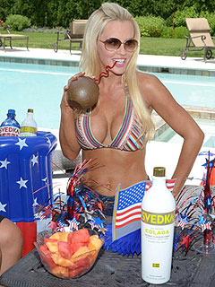 PHOTO: Jenny McCarthy Enjoys a Poolside Cocktail – in a Bikini!