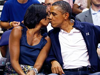 President Obama and First Lady Caught Smooching on Kiss Cam | Barack Obama, Michelle Obama