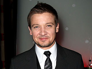 Jeremy Renner Gets Handy to Rein His Dogs In