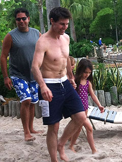 Tom Cruise and Suri Catch Waves at Disney World Surf Pool| Walt Disney World, Suri Cruise, Tom Cruise