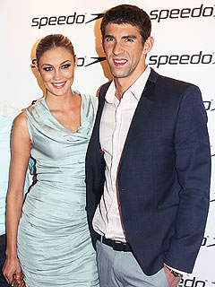PHOTO: Michael Phelps & Megan Rossee Get Cozy at Olympic Celebration | Michael Phelps