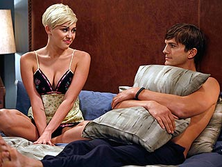 Why Is Miley in Bed with Ashton? (Photo) | Ashton Kutcher, Miley Cyrus