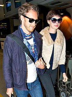 PHOTO: Anne Hathaway Returns from Honeymoon Looking Glam | Adam Shulman, Anne Hathaway