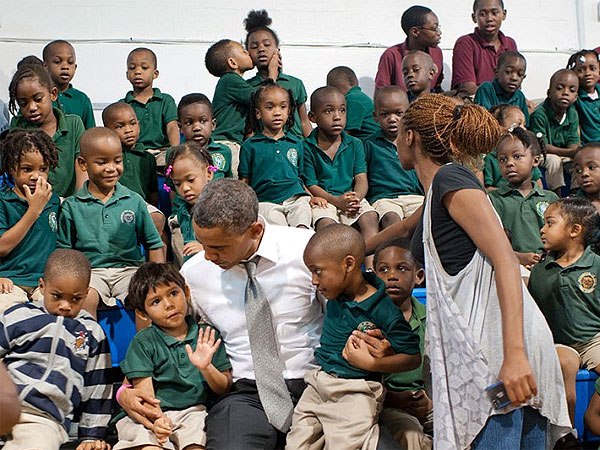 President Barack Obama Gets Photobombed by a Young Boy