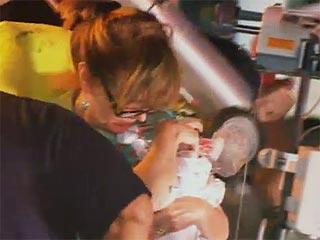 nurse respirating baby