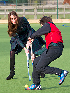 PHOTO: Kate Plays Field Hockey in High-Heeled Suede Boots | Kate Middleton