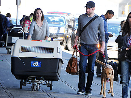 Emily Blunt Pushes Dog Carrier