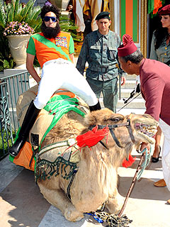 Saddle Up! The Dictator Rides Into Cannes on a Camel | Sacha Baron