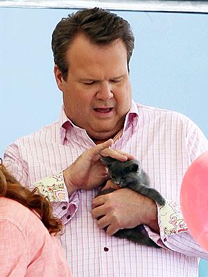 Eric Stonestreet Cuddles Up to a Kitten on Set