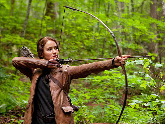 What is Katniss's weapon of choice in The Hunger Games?