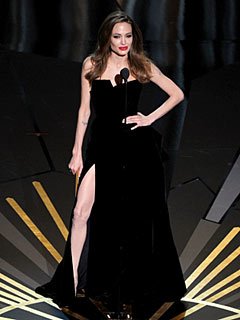 How Angelina Jolie&#39;s Right Leg Became the Breakout Star of the Oscars | Angelina Jolie