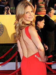 Kyra Sedgwick in coral 'Emilio Pucci' dress